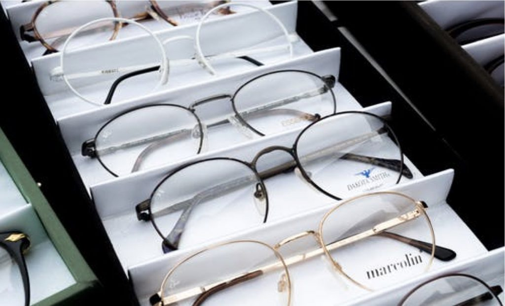 A wholesale tray of eyeglasses